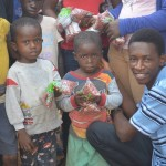 Faliku Dukuly shares food with hungry Liberian children.