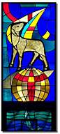 The lamb symbolizes the meek. The water represents the living water. The fish represents Christianity. The window is at Saint Vincent de Paul Catholic Church in Seward, NE.