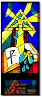 The Rays of the Holy Trinity flow downward to the Bible and the Baptismal shell representing righteousness for which they hunger and thirst. The Staff and Cross represent the Lord as our Shepherd.  (Stained glass windows at St. Vincent de Paul Catholic Church in Seward, NE). http://www2.connectseward.org/chu/stv/index.htm